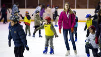 Some children skating on the ice