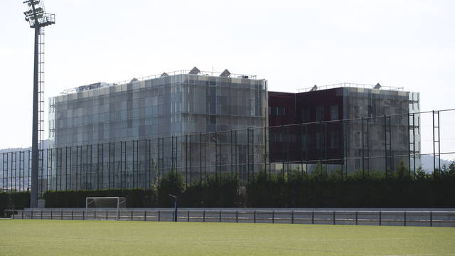 View of the new masia building from one of the fields