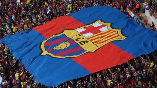 large barça flag covering a section of the stadium