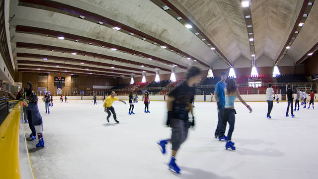 Photo of young people skating on the ice rink