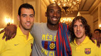 Kobe with Busquets and Puyol
