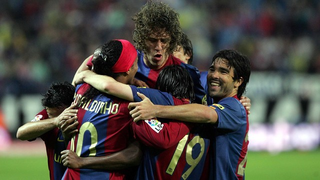 Puyol celebrates with Ronaldinho and team-mates
