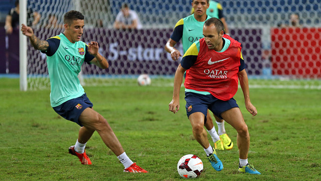 Iniesta and Tello in training / PHOTO: MIGUEL RUIZ - FCB