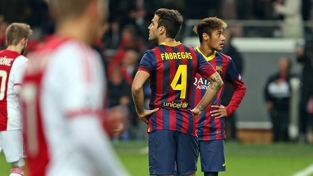 Cesc and Neymar stare upward in disbelief after Ajax score