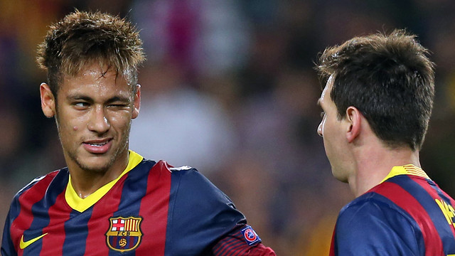 Neymar winks at Messi during the match