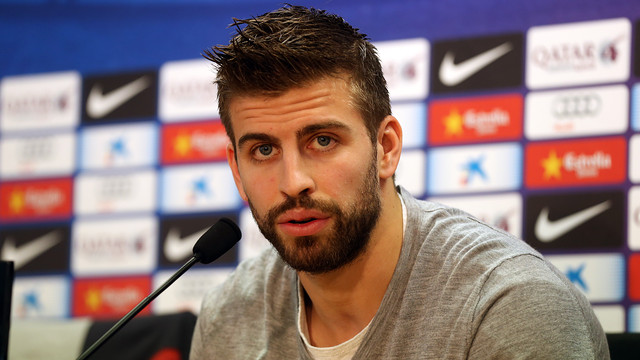 Piqué speaking into a microphone