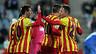 Messi celebra el 0-1 a Getafe amb Adriano.