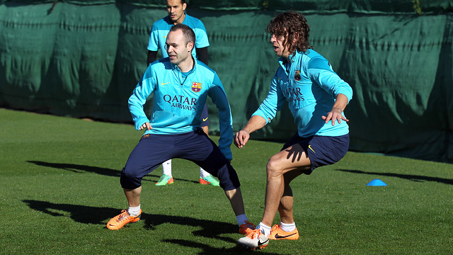 Iniesta and Puyol at this Monday's training