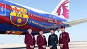 Qatar Airways hostesses alongside the Barça plane