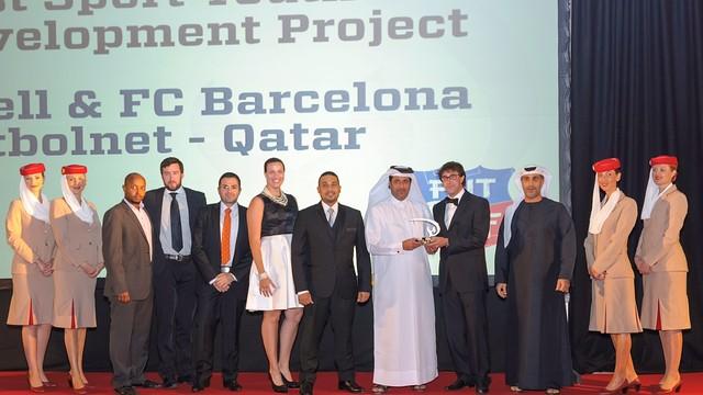 FutbolNet representatives recieve the award on stage in Dubai