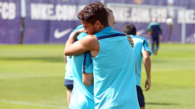 Dos Santos and Iniesta hugging