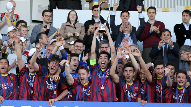Juvenil A captain, Roger Riera, lifts the trophy as winners of the youth version of the Champions League