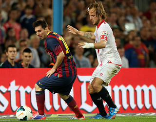 Leo Messi and Rakitic challenging for the ball