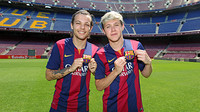 The members of One Direction in Barça shirts