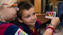 Two children admire their child passports. PHOTO: GERMÁN PARGA / FCB