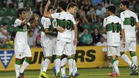 Elche players celebrate a goal against Vilarreal