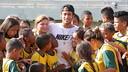 Some children hug Neymar at the Instituto facilities.