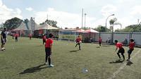 Children playing football at FCB Escola Sao Paulo