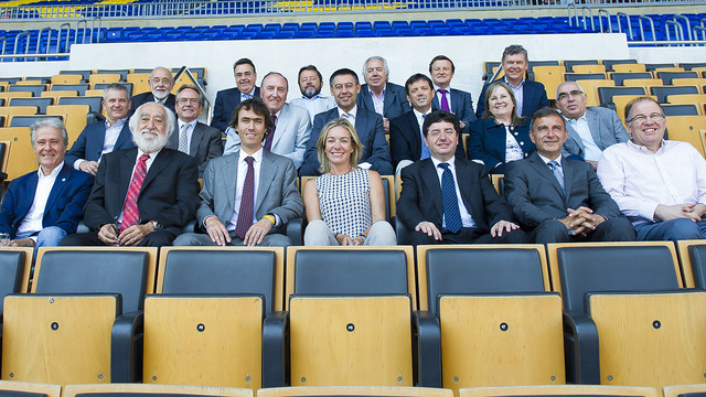 The members of the Foundation's board of directors are sit in the stands of the Camp Nou