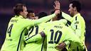 Barça players high-five after scoring one of their five goals at San Mamés. / MIGUEL RUIZ-FCB