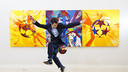 John Farnworth in front of Damien Hirst's Messi-inspired work / Sotheby's