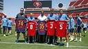 San Francisco 49ers offensive tackle Joe Staley and free safety Eric Reid pose with FC Barcelona midfielders Andrés Iniesta and Sergio Busquets, and defender Gerard Piqué at Levi's Stadium on Friday, July 24th 2015. / MIGUEL RUIZ-FCB