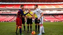 The two captains shaking hands before the game / NIKE ACADEMY