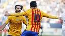 Arda Turan y Leo Messi celebran un gol contra el Malaga / MIGUEL RUIZ-FCB